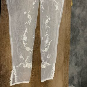 White Sleeves that are beaded.